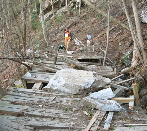 Debris from the rockslide destroyed a footbridge on the trail, which remains closed.