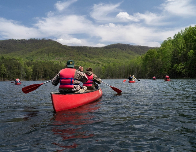 A group of visitors recently enjoyed a 'canoe hike' on the property's 20-acre lake.