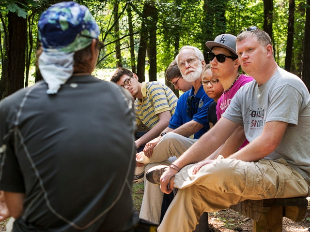 Students and teachers from The Governor Morehead School for the Blind listen to blind hiker Trevor Thomas.