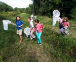 Girl scouts, and friends, try their luck at capturing Monarch butterflies during a tagging program at Falls Lake.
