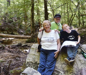 The brothers and grandmother Ernestine Webb take a break during a trip to the mountains.