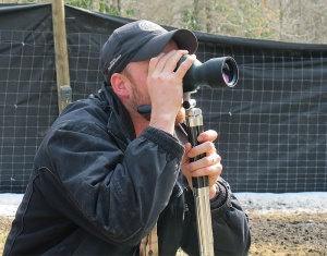 Supervisory biologist, Dr. Caleb Hickman of the Eastern Band of Cherokee Indians Fisheries and Wildlife Management Department, observes a herd of white-tailed deer reintroduced into the wild.  (Photo: Eastern Band of Cherokee Indians)