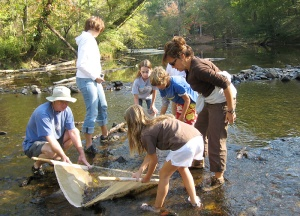 Students search for aquatic life at Eno River State Park.