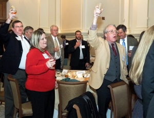 Mike Leonard of The Conservation Fund (right) leads attendees in the state toast.