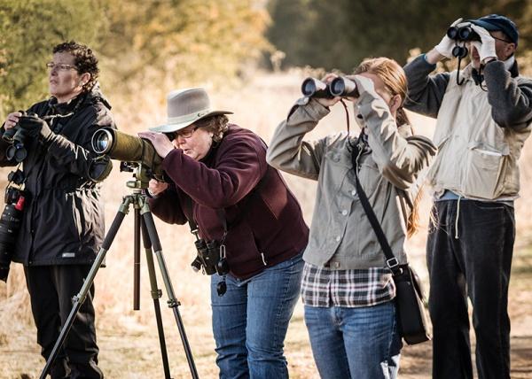 Edith Tatum, second from left, leads a birding program Saturday morning.