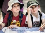 Young boys fill out Junior Ranger workbooks.