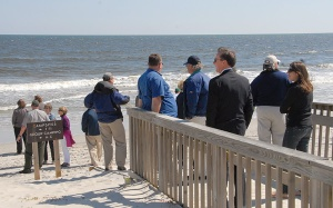 Authority members tour beach facilities on Bear Island.