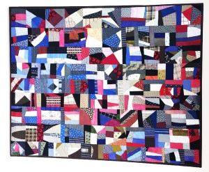 Replacement quilt uses the 'stacked bar', crazy-quilt pattern of the Royal family heirloom.