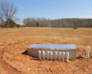 Old farm field for subsurface system will be replanted, but trees aren't allowed.