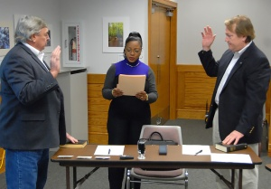 Two serving members of the N.C. Parks and Recreation Trust Fund Authority began new terms Dec. 5. Neal Lewis, left, of New Hanover County and Edward W. Wood of Chowan County are sworn by Rachel Gooding of the N.C. Division of Parks and Recreation staff.
