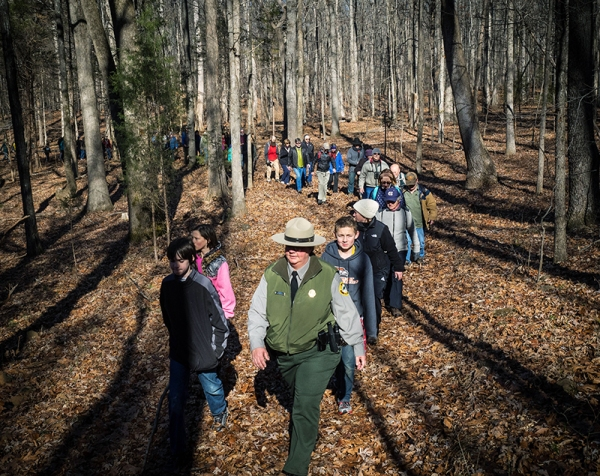 Park Superintendent Kelley King leads hikers along a new trial at Haw River State Park.