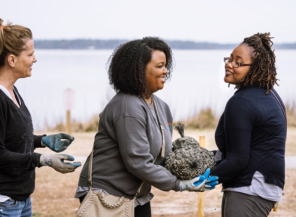 Meredith College students unload components of a new oyster reef at Carolina Beach State Park.