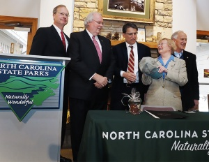 From left, Donald van der Vaart, secretary of the N,C. Department of Environment and Natural Resources, Mike Murphy, state parks director, Gov. McCrory, Jean Spooner of the Amsted Coalition, Alex Bernhardt, Chairman of Bernhardt Furniture.