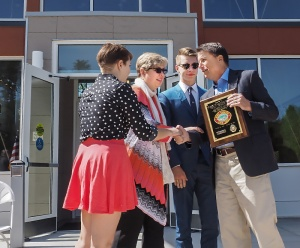 Gov. McCrory presents a plaque honoring Supt. Casey Rhinehart's service to daughter Kinsey Rhinehart, wife Jill Rhinehart and son Nick Rhinehart.