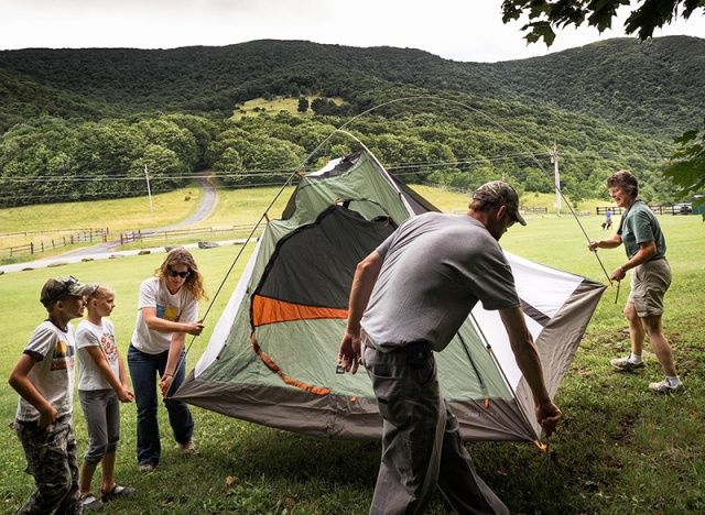 Ranger Kelly Safley, right, helps the Evans family position its tent at the Elk Knob State Park campout.