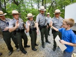 New Junior Rangers get high fives from the park's ranger staff.